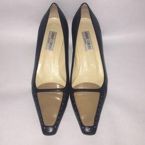 Jimmy Choo Black and tan leather slip on heels